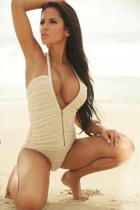 brunette on beach showing cleavage
