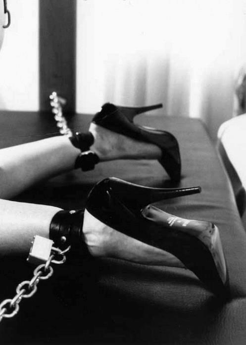high heels leg shackles chained to bed