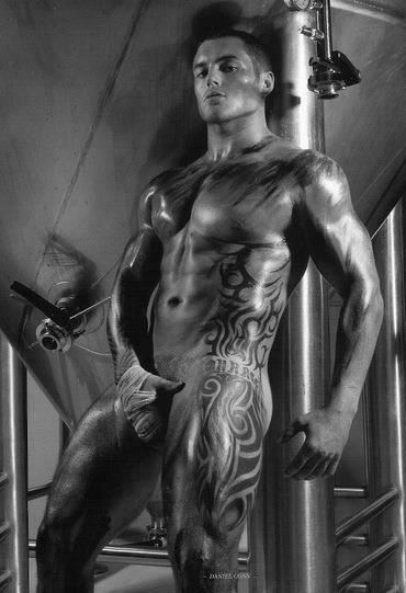 muscular naked guy with tattoos